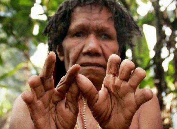 Tradisi Potong Jari Suku Dani Papua